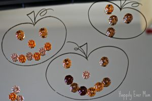 Jack o lanterns mirro and loose parts - Happily Ever Mom
