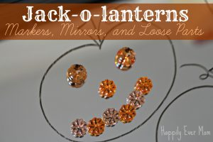 Jack o lanterns with a mirror and loose parts - Happily Ever Mom