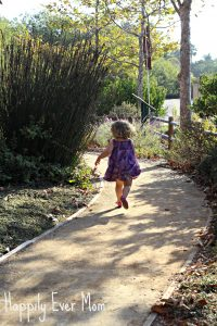 Lil running to flowers