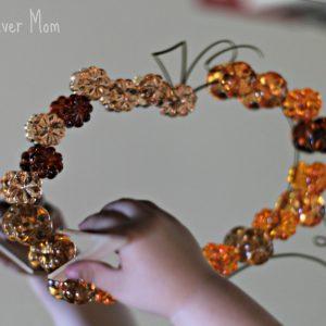 Jack-O-Lantern Play: Loose Parts on a Mirror