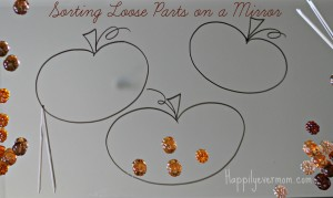 Pumpkin sorting on a mirror - Happily Ever Mom