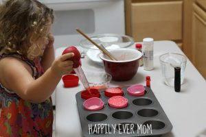 Adding vinegar to erupting cupcakes from Happilyevermom