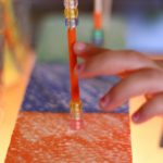 Fine Motor Station on the Light Table: Skewers, Pony Beads, and Straws
