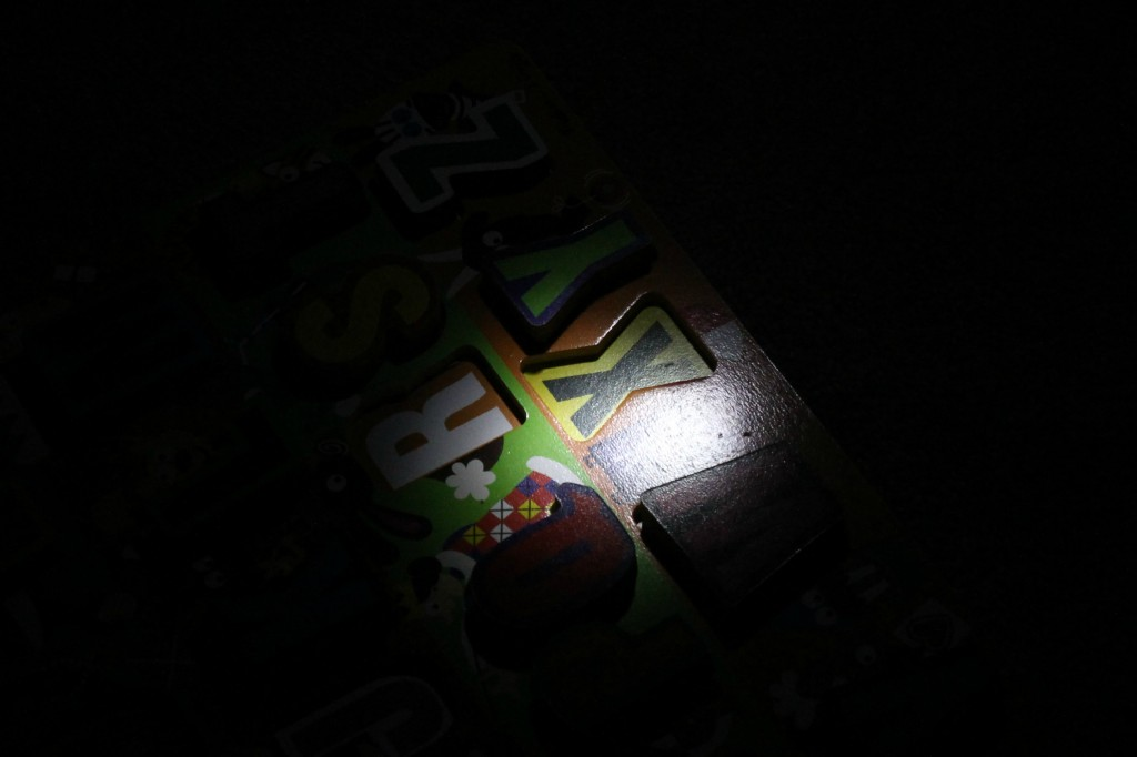Flashlight Alphabet Game L figures out which letters are missing from Happilyevermom