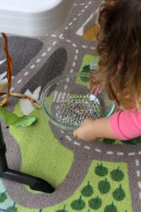 Introducing water beads and putting them in the pretend oven from Happilyevermom