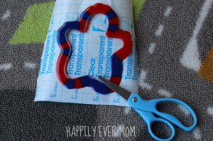 Pony Bead outline, contact paper, and scissors from Happilyevermom