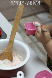 Scooping batter for erupting cupcakes from Happilyevermom