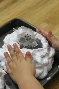 Stackable Egg Carton Snowmen L touches the shaving cream mountain