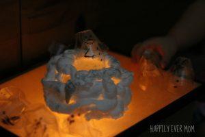 Stackable Egg Carton Snowmen on the light table with a shaving cream mountain