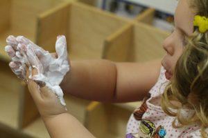Stackable egg carton snowmen L rubs frozen shaving cream on her hands