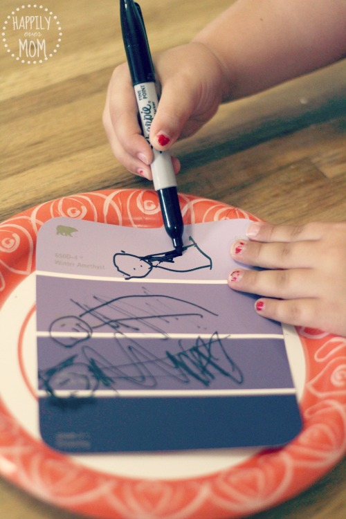 L drawing her own paint chip puzzles for kids