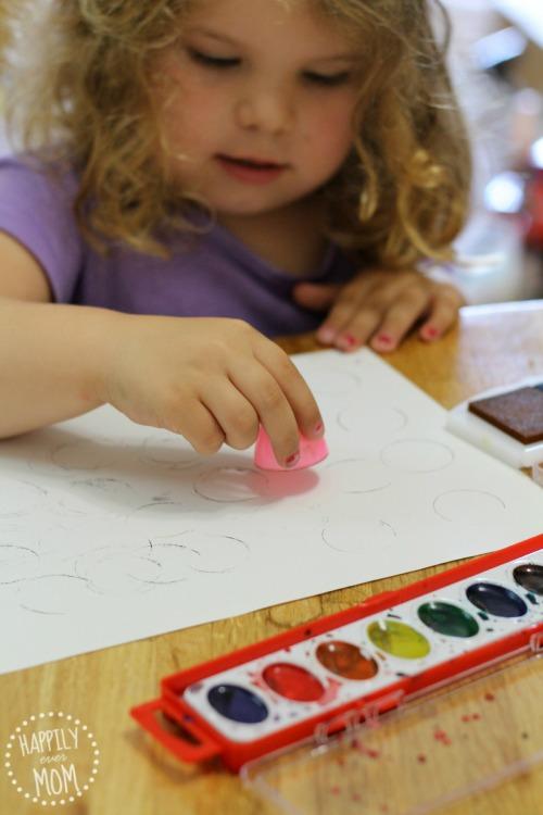 Plastic egg art stamping and watercolors art for preschoolers