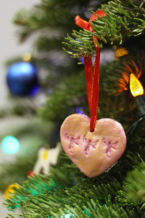 Love this way to honor a loved one with a kid-made ornament! Just use something that...