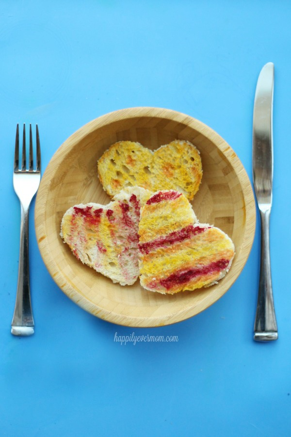 Deliciously simple rainbow toast for Valentine's day with natural food coloring kids can make.