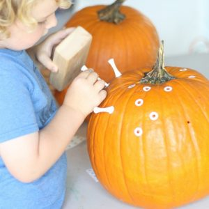 A Fun New Twist for Kids to Practice Aim: Hammering Golf Tees into Pumpkins!