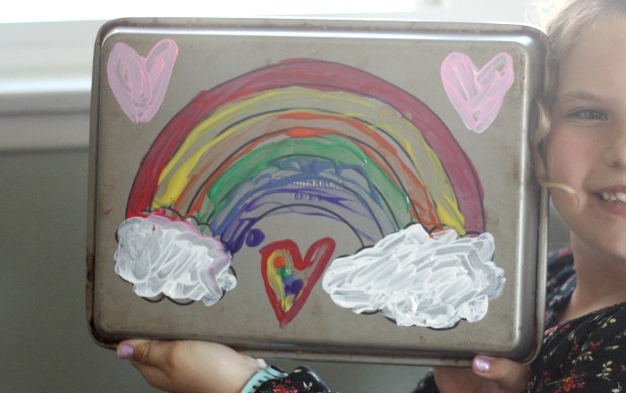 Easy painting activity with a cookie sheet. Read why you should be making this right now with your kids and how to clean it all up easily.