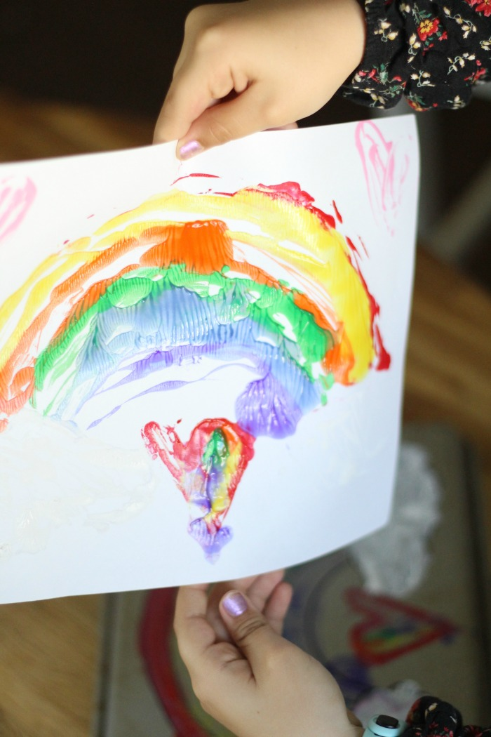 Easy cookie sheet prints. Make a rainbow or whatever design you'd like. Fun boredom buster for kids in the summer!